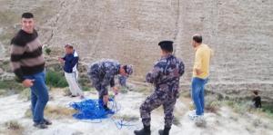 انقاذ اردني سقط في منحدر جبلي باربد