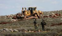 مستوطنون يجرفون أراضٍ في جنوب نابلس