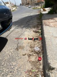 هبوط شارع في شفا بدران يهدد سور بناية سكنية (صور)