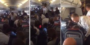 طائرة ركاب تتحول لحلبة مصارعة (فيديو)