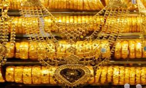 الذهب يرتفع للأسبوع الثاني مع انخفاض الدولار