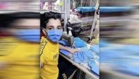 ما جنسية الطفل الذي يصنع الكمامات؟