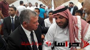 الملك في بيت عزاء الشهيد محمد الجواودة (صور)
