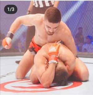 فوز اللاعب فارس الدوايمه ببطولة الفنون القتالية (MMA) - صور