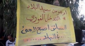 """سائقو التكسي الأصفر: """"صرنا لاجئين في الأردن"""""""