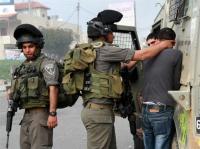 حملة اعتقالات تطال 14 فلسطينيا بالضفة الغربية
