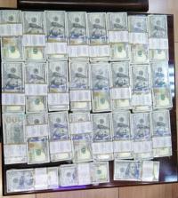 عمان ..  الامن يحبط عملية احتيال بقيمة 250 الف دولار مزيف