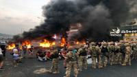 محتجون لبنانيون يغلقون طريق المطار ببيروت