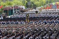 قتلى وجرحى بهجوم استهدف عرضا عسكريا في إيران